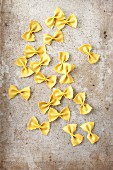 Turmeric farfalle on metal surface