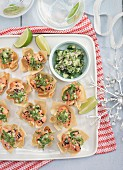 Salmon wontons with green salsa