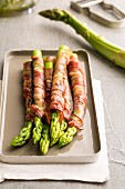 Asparagus wrapped in ham