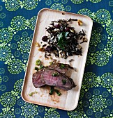 Teriyaki sirloin steak with ginger and cranberry wild rice