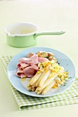 White asparagus with an egg sauce, ham and potatoes