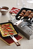 Skewers and omelette in raclette pans