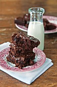 Brownies with chocolate glaze and a bottle of milk