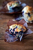 Blueberry muffins in paper