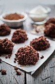 Chocolate oat cakes on a piece of baking paper