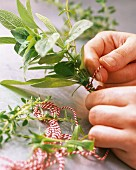 A bunch of herbs being tied