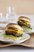 Hamburgers with Cheddar cheese and gherkins