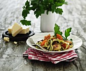 Tagliatelle with parsley pesto, tomatoes and meatballs