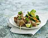 Marinated pork skewers with sesame seeds