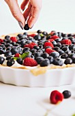 A shortcrust tart with blueberries and raspberries