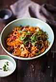 Carrot salad with sausage, coriander and a yoghurt dressing