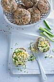 Herb bread rolls topped with chopped egg salad