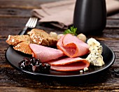 Ham and pickles with Stilton cheese, pickled onions and bread