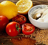 Lemons, tomatoes, mustard seeds, chilli powder and mayonnaise