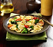 Orecchiette pasta with broccoli, tomatoes and chilli flakes