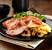 Sweet smoked bacon with a cheese omelet, mushrooms and watercress