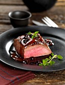 Venison steak with a juniper berry sauce