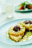 Chicken breast fillets with pineapple, lingonberries and cheese