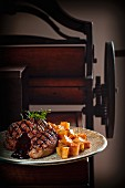 Grilled steak with fried potatoes and barbecue sauce