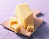Butter cheese on a chopping board