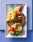 Veal escalope with fried rice, peppers and spring onions