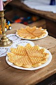 Fresh waffles on a rustic wooden table