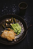 Beer battered cod with mashed potatoes and peas, gherkins and garlic