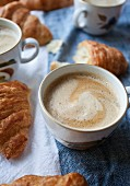 Coffee and croissants on a breakfast table