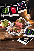 Beef steak in aluminium foil with courgette and spinach