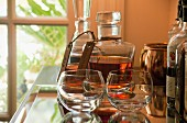A whiskey decanter, glasses and bottles