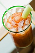 Bloody Mary with celery and ice cubes