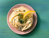 Spaghetti with a creamy lemon sauce and thyme