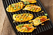Spicy grilled mango slices with chilli peppers