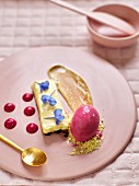 White chocolate mousse with vanilla and beetroot ice cream and edible flowers