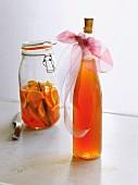 Homemade orange liqueur with vanilla in a decorative bottle