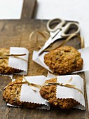 Wholemeal cookies wrapped individually in pieces of paper as gifts