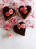 Heart-shaped chocolate cakes decorated with marzipan roses