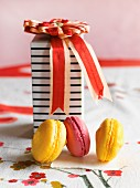 Macaroons in front of a decorative gift box