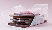 Bars of chocolate tied with ribbon