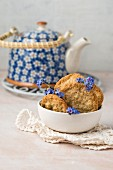 Oat biscuits with forget-me-nots and a teapot