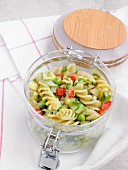 Pasta salad with vegetables in a takeaway jar