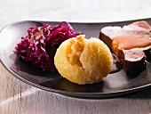 Roast pork with a dumpling and red cabbage