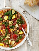 Vegan minestrone soup with kale, courgette, chickpeas and quinoa