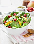Spinach salad with raspberries, mango and vinaigrette