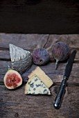 Fourme D'Ambert (French blue cheese) and wine hard cheese from Italy with fig