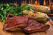 Grilled spare ribs and corn cobs