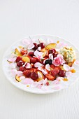 Fruit salad with edible flowers