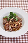 Lamb chops on a bed of rice with walnuts