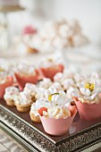 Wedding cupcakes on a silver tray for a wedding buffet
