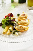 Potato pasty parcels with asparagus salad